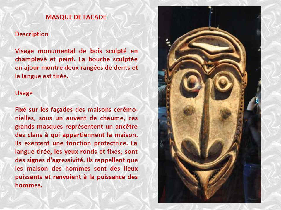 MASQUE DE FACADE Description Visage monumental de bois sculpté en champlevé et peint.