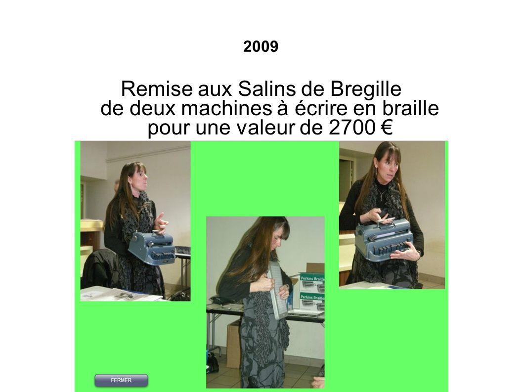 2009 Remise aux Salins de Bregille de deux machines à écrire en braille pour une valeur de 2700 €