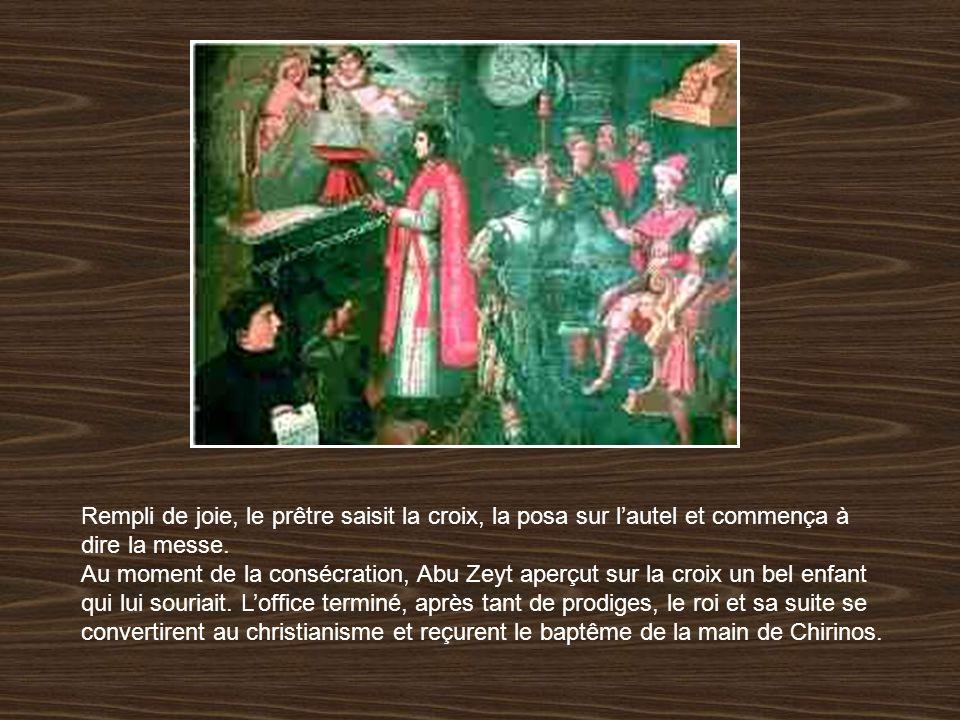 Rempli de joie, le prêtre saisit la croix, la posa sur l'autel et commença à dire la messe.
