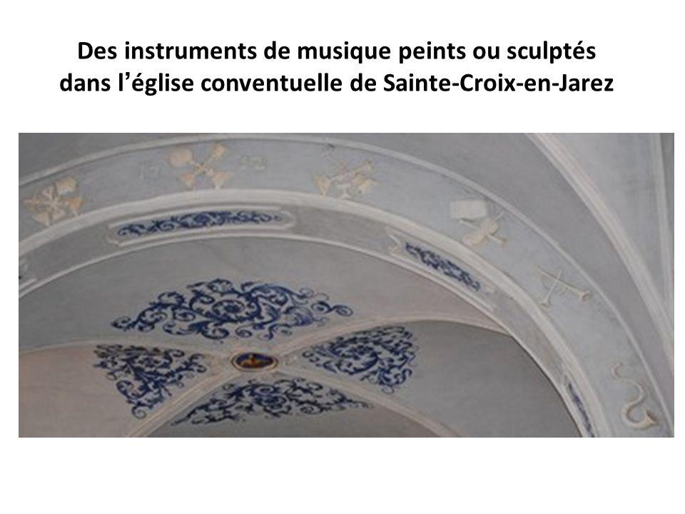 Des instruments de musique peints ou sculptés dans l'église conventuelle de Sainte-Croix-en-Jarez