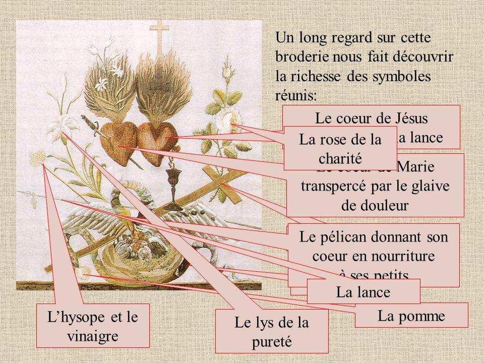 Le coeur de Jésus transpercé par la lance La rose de la charité