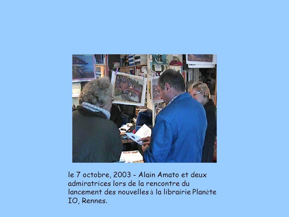 le 7 octobre, 2003 - Alain Amato et deux admiratrices lors de la rencontre du lancement des nouvelles à la librairie Planète IO, Rennes.