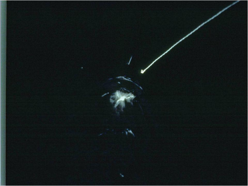 Cette diapositive montre un écouvillon de Moore au bout d une ligne dans de l eau en mouvement.