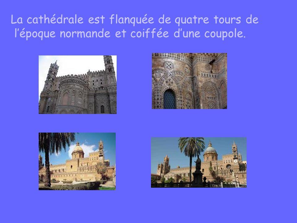 La cathédrale est flanquée de quatre tours de l'époque normande et coiffée d'une coupole.