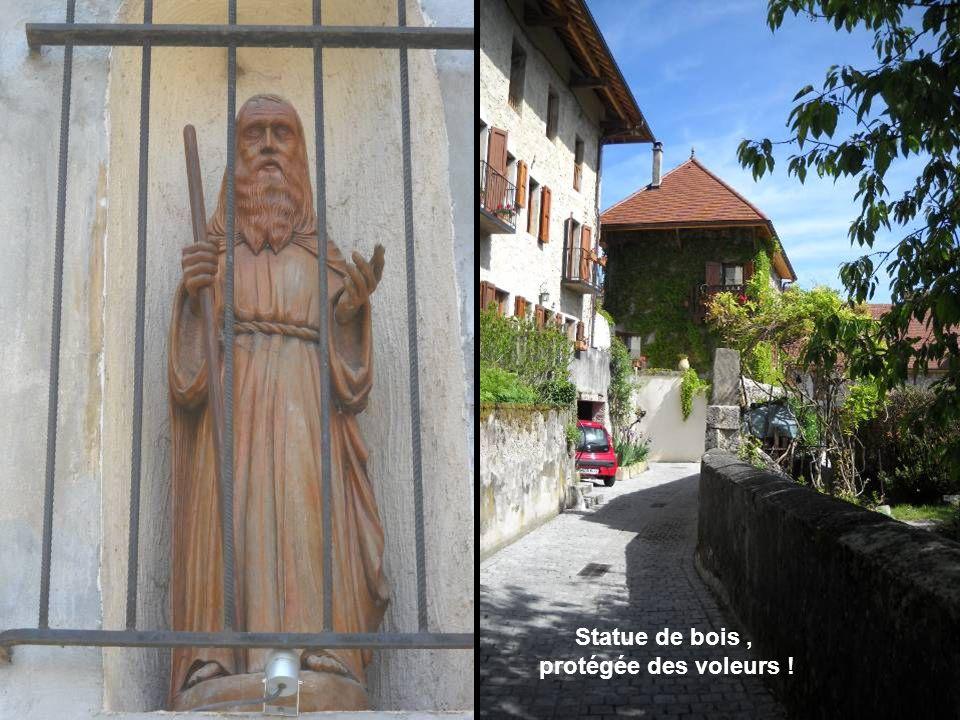 Statue de bois , protégée des voleurs !