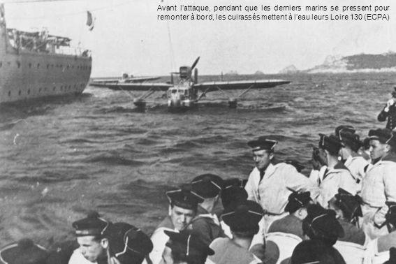 Avant l'attaque, pendant que les derniers marins se pressent pour remonter à bord, les cuirassés mettent à l'eau leurs Loire 130 (ECPA)
