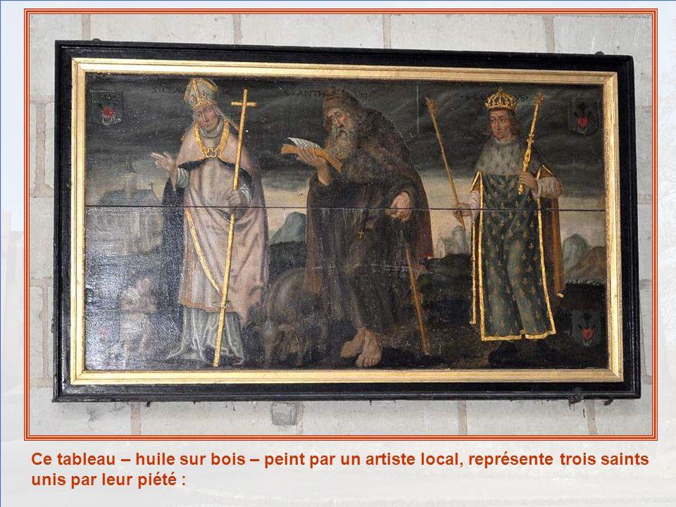 Ce tableau – huile sur bois – peint par un artiste local, représente trois saints unis par leur piété :