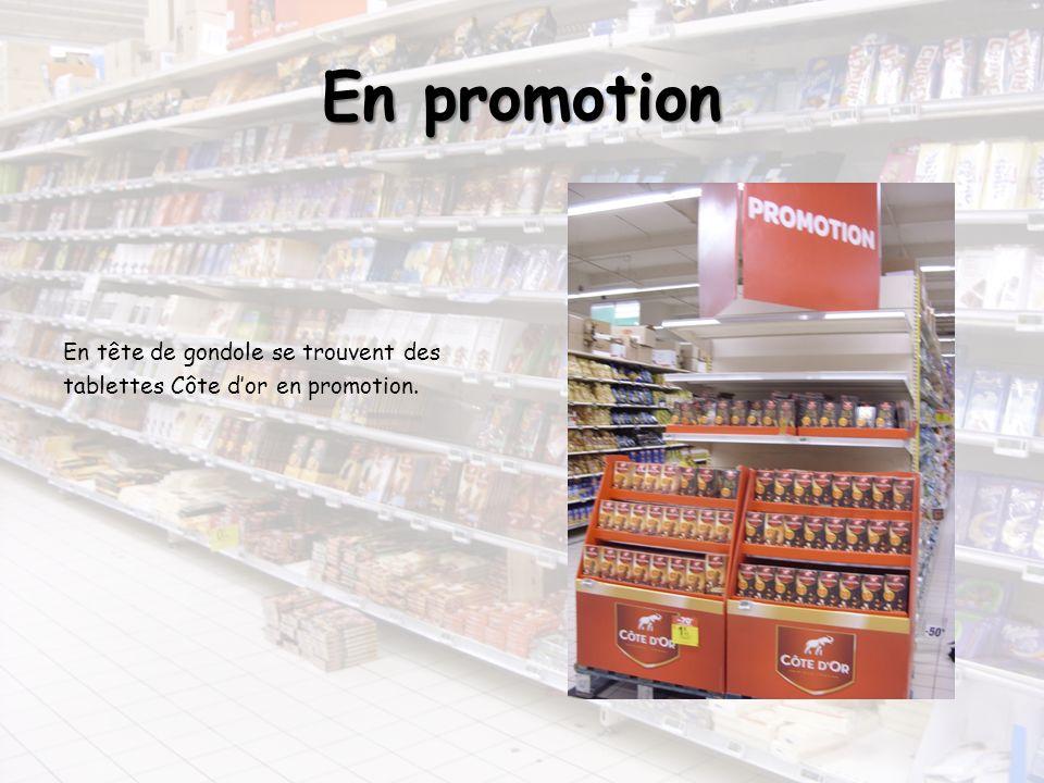 En promotion En tête de gondole se trouvent des tablettes Côte d'or en promotion.