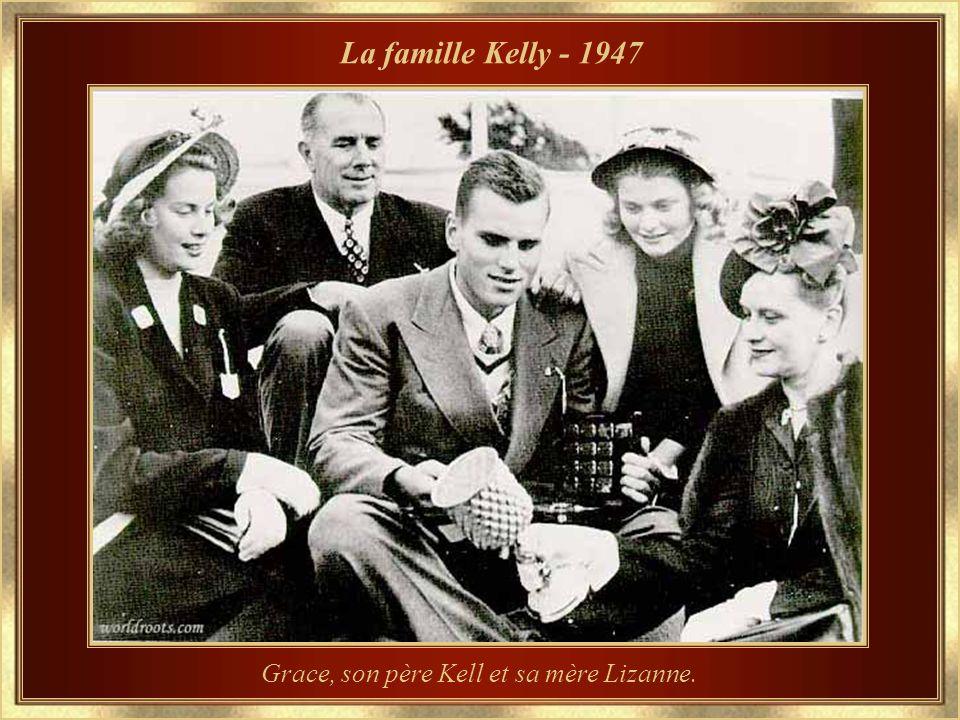 Grace, son père Kell et sa mère Lizanne.