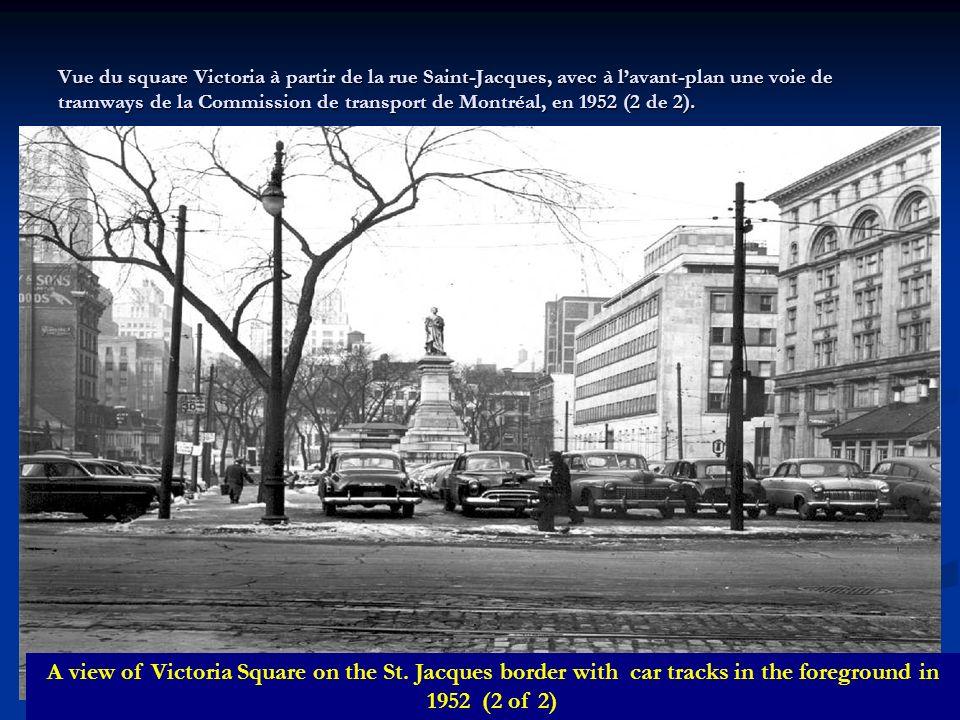 Vue du square Victoria à partir de la rue Saint-Jacques, avec à l'avant-plan une voie de tramways de la Commission de transport de Montréal, en 1952 (2 de 2).