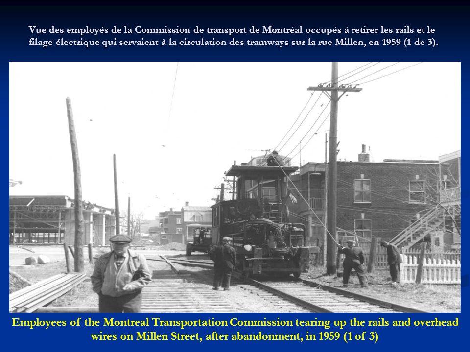 Vue des employés de la Commission de transport de Montréal occupés à retirer les rails et le filage électrique qui servaient à la circulation des tramways sur la rue Millen, en 1959 (1 de 3).