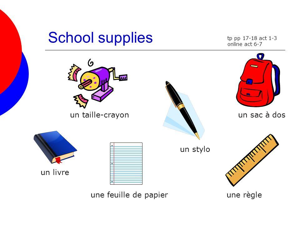 School supplies un taille-crayon un sac à dos un stylo un livre