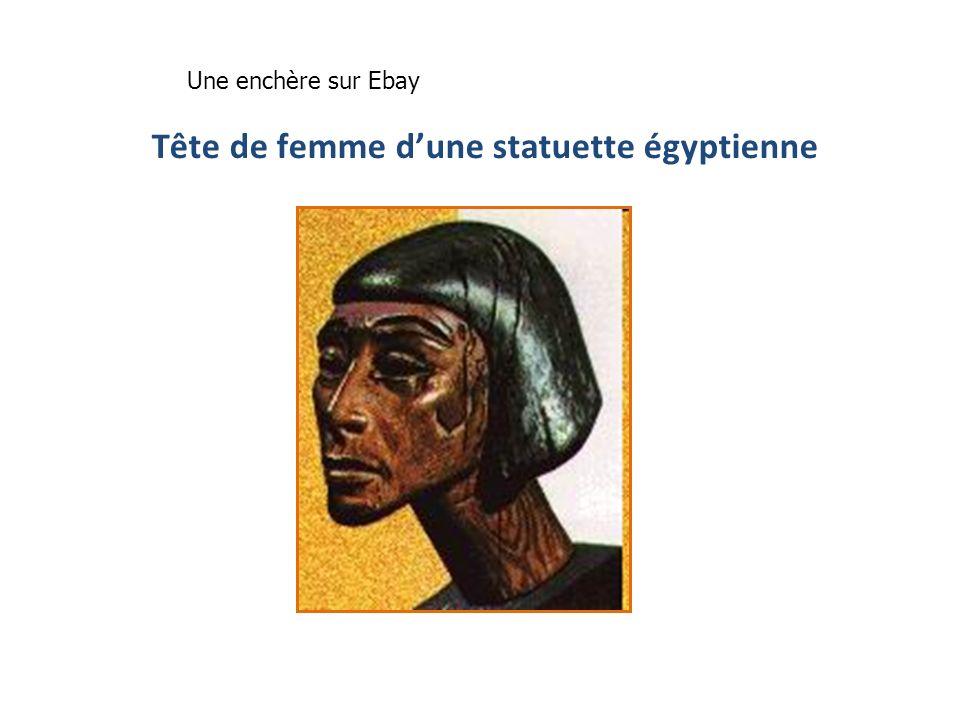 Tête de femme d'une statuette égyptienne
