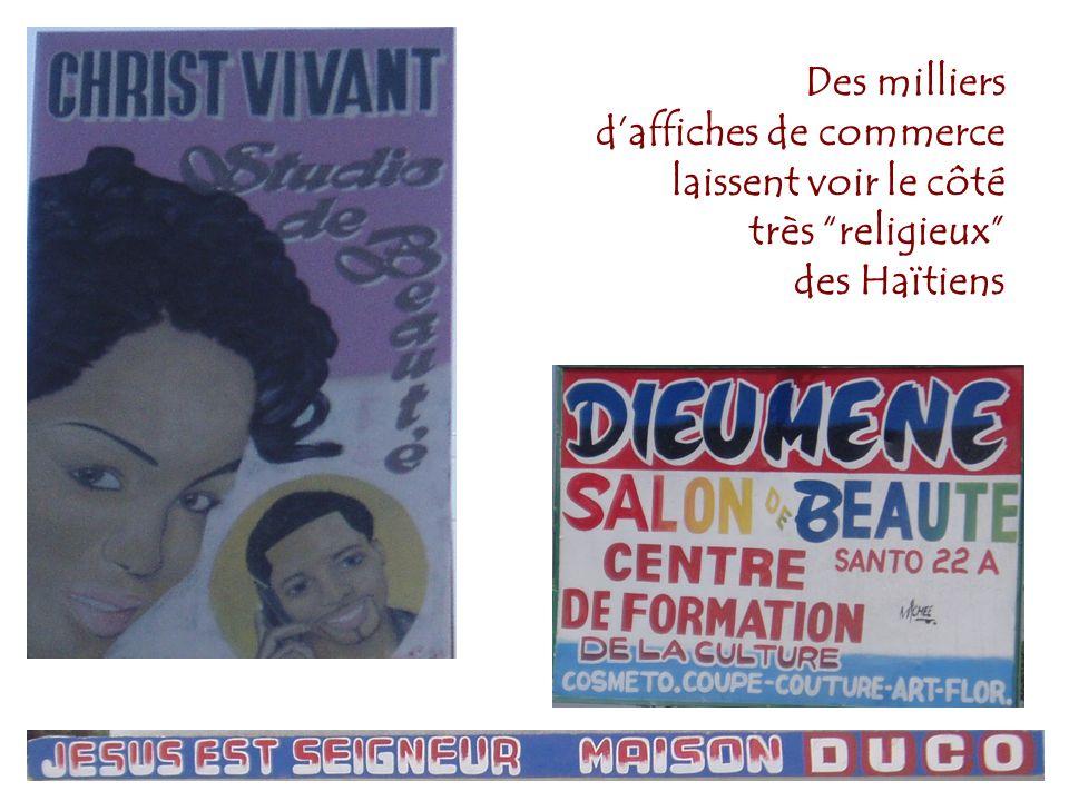 Des milliers d'affiches de commerce laissent voir le côté très religieux des Haïtiens