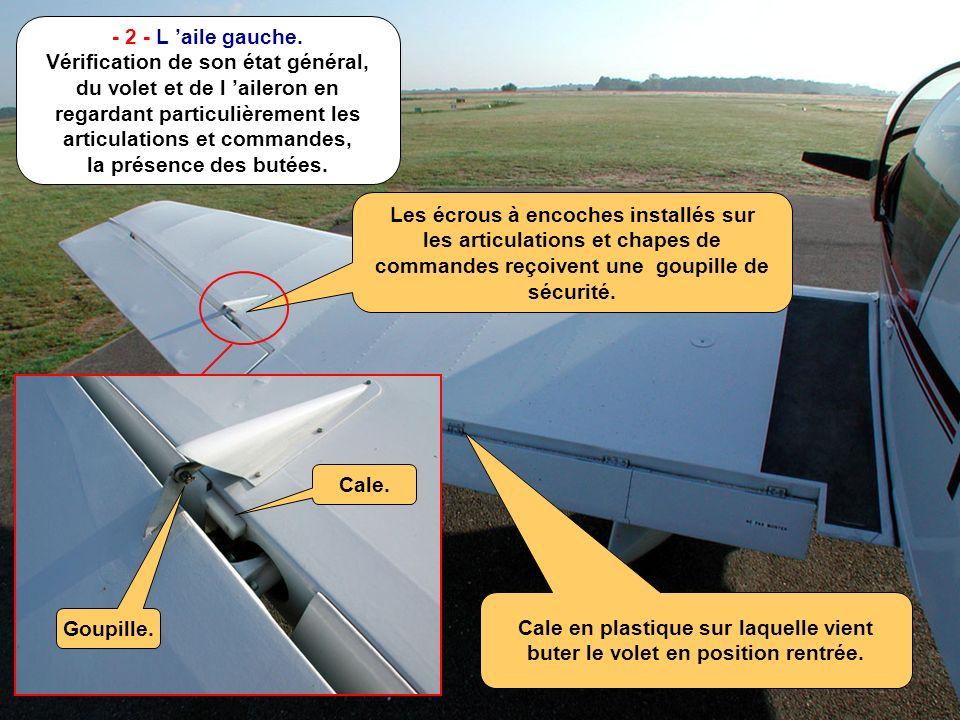 - 2 - L 'aile gauche. Vérification de son état général, du volet et de l 'aileron en regardant particulièrement les articulations et commandes, la présence des butées.
