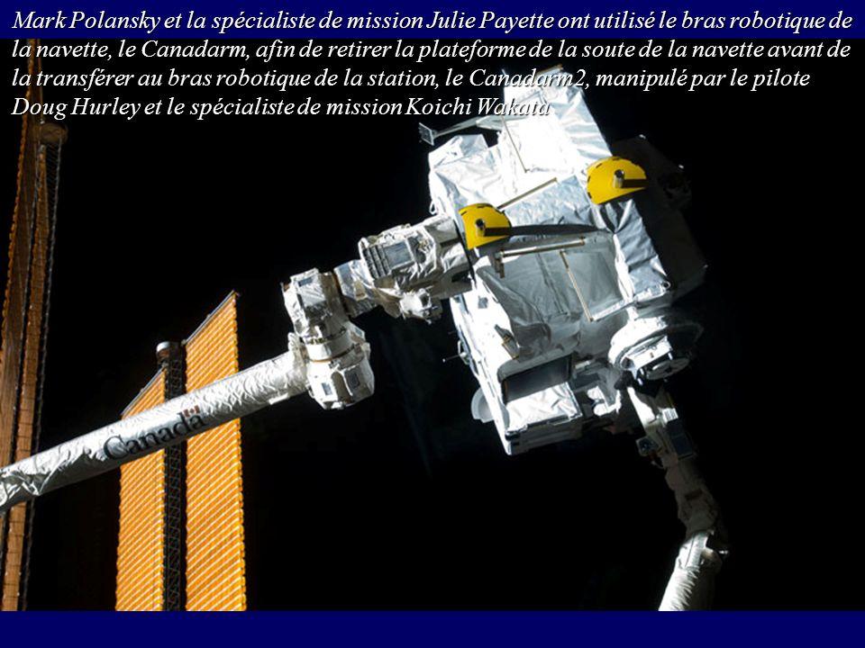 Mark Polansky et la spécialiste de mission Julie Payette ont utilisé le bras robotique de la navette, le Canadarm, afin de retirer la plateforme de la soute de la navette avant de la transférer au bras robotique de la station, le Canadarm2, manipulé par le pilote Doug Hurley et le spécialiste de mission Koichi Wakata