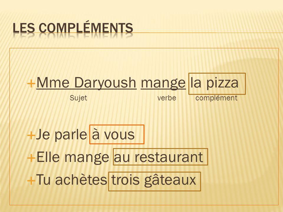 Mme Daryoush mange la pizza