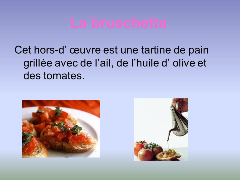 La bruschetta Cet hors-d' œuvre est une tartine de pain grillée avec de l'ail, de l'huile d' olive et des tomates.