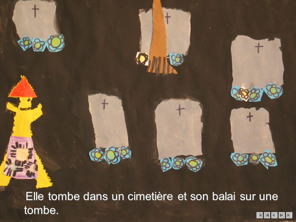 Elle tombe dans un cimetière et son balai sur une tombe.