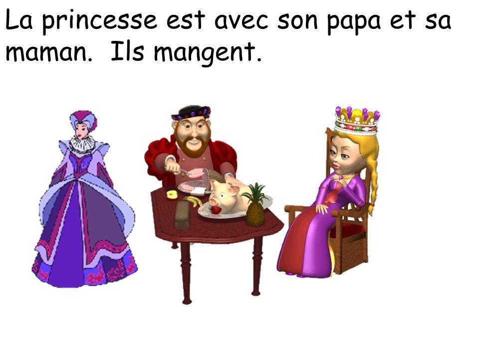 La princesse est avec son papa et sa maman. Ils mangent.