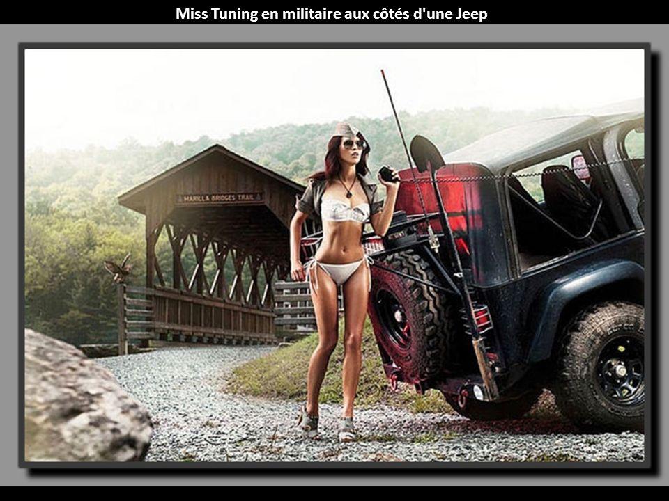 Miss Tuning en militaire aux côtés d une Jeep