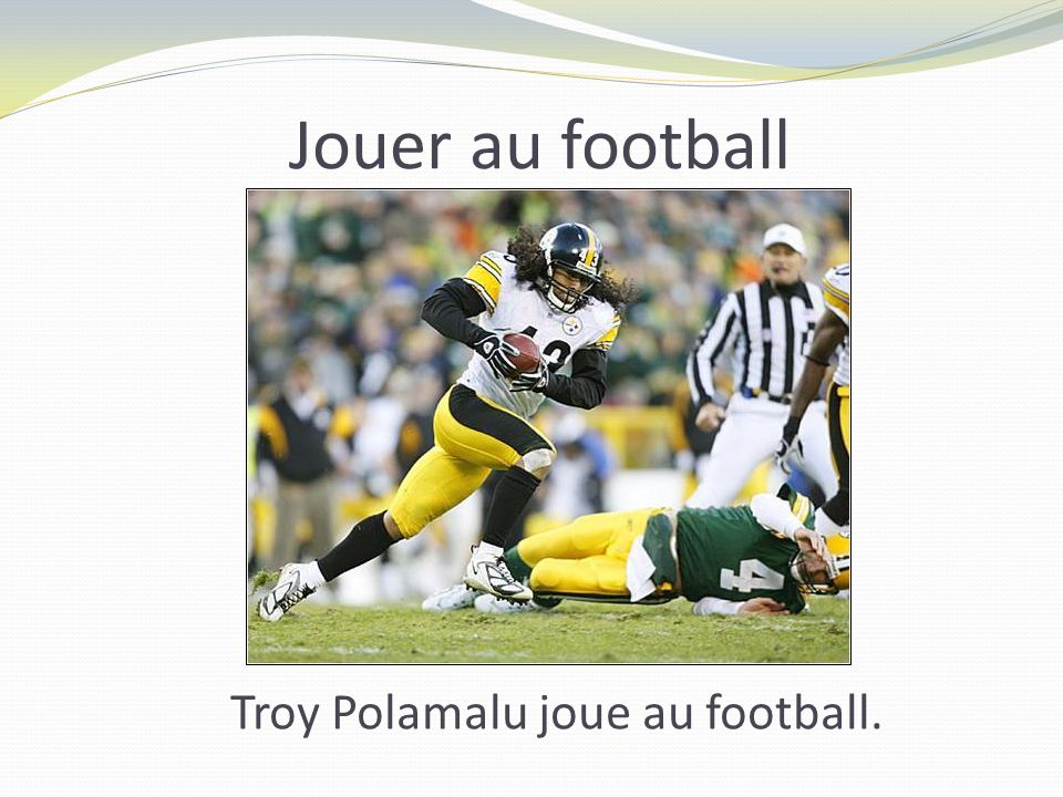 Jouer au football Troy Polamalu joue au football.