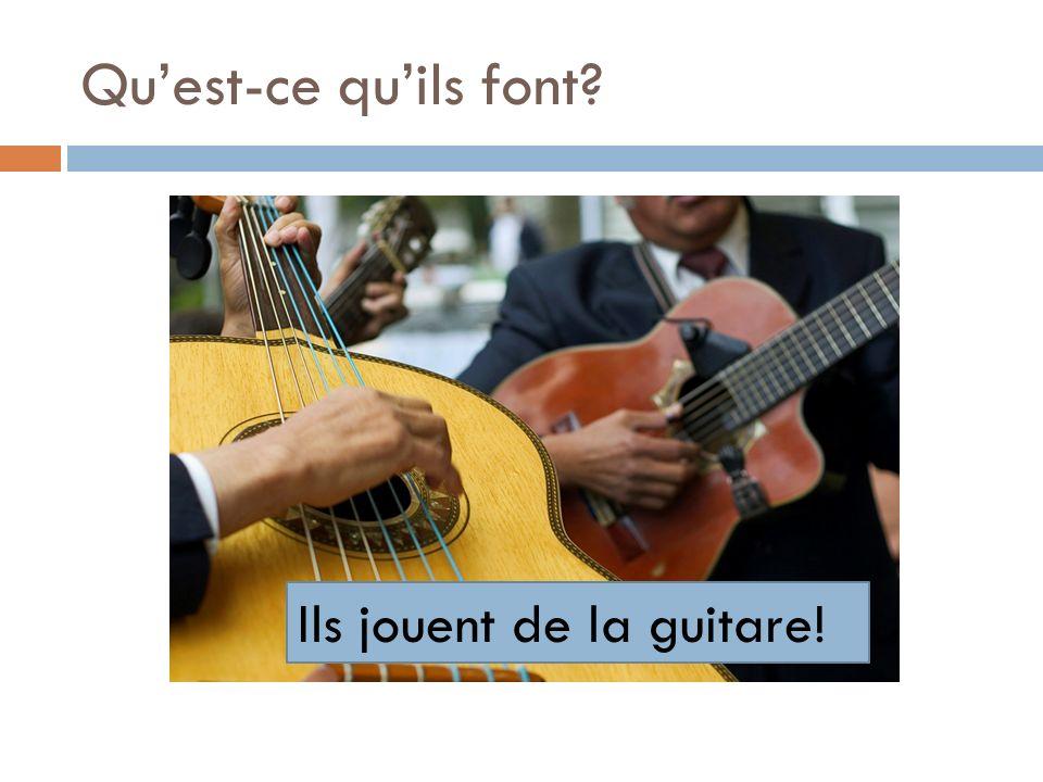 Qu'est-ce qu'ils font Ils jouent de la guitare!