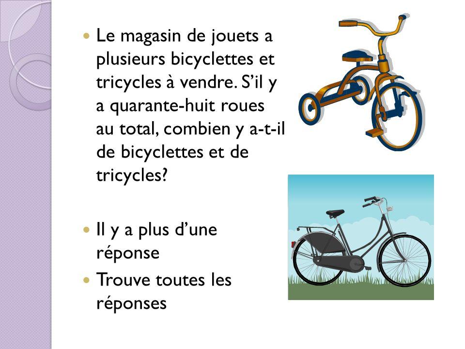 Le magasin de jouets a plusieurs bicyclettes et tricycles à vendre