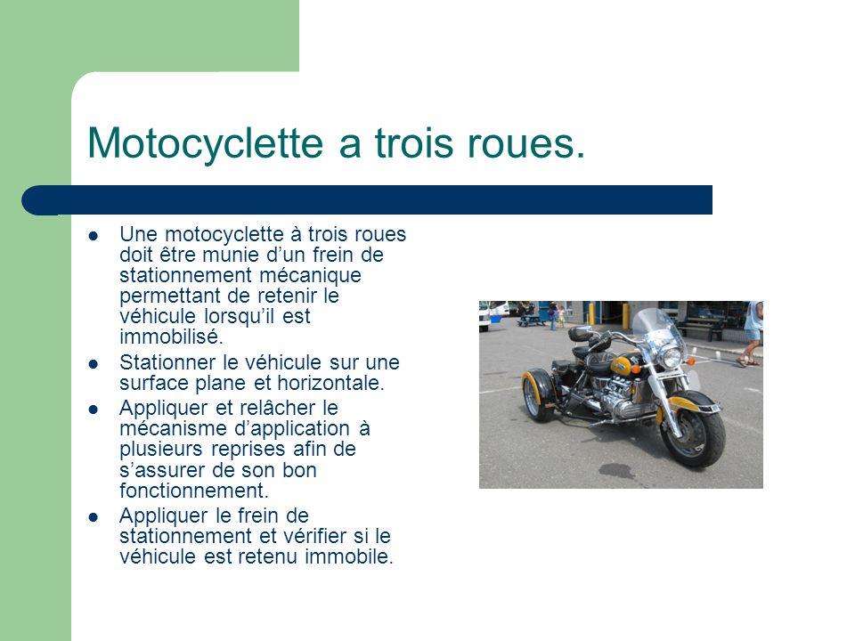 Motocyclette a trois roues.