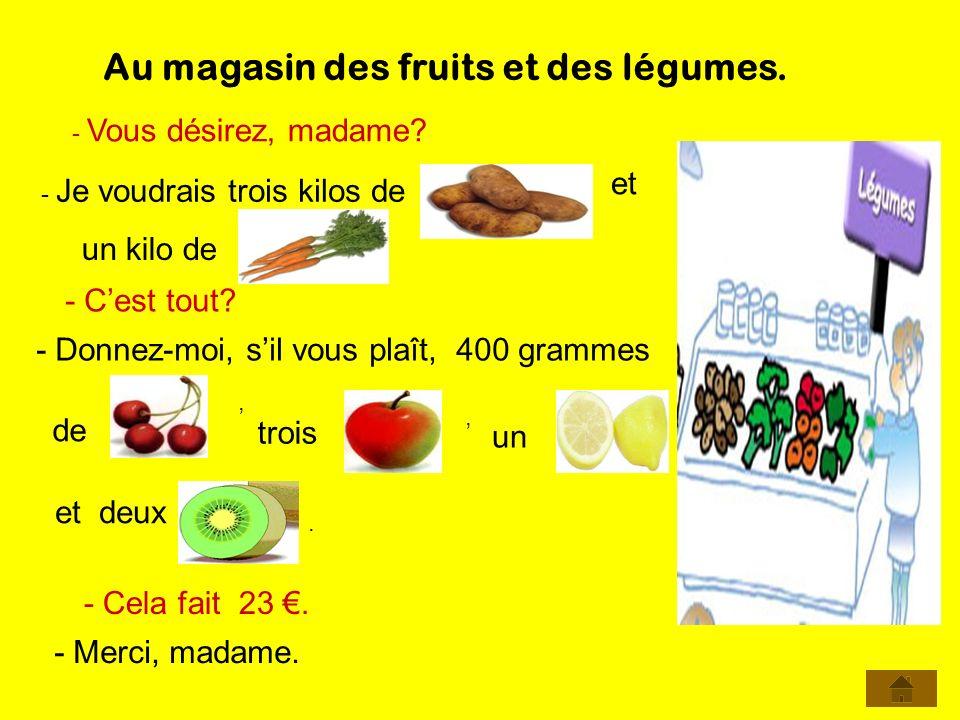 Au magasin des fruits et des légumes.