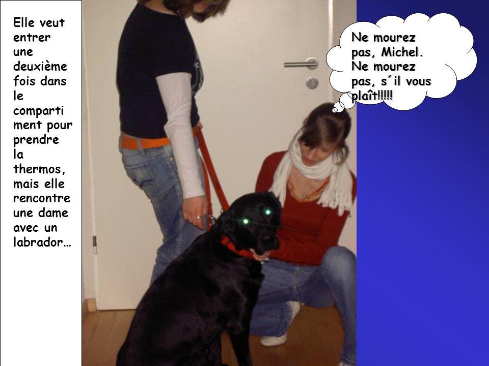 Elle veut entrer une deuxième fois dans le compartiment pour prendre la thermos,mais elle rencontre une dame avec un labrador…