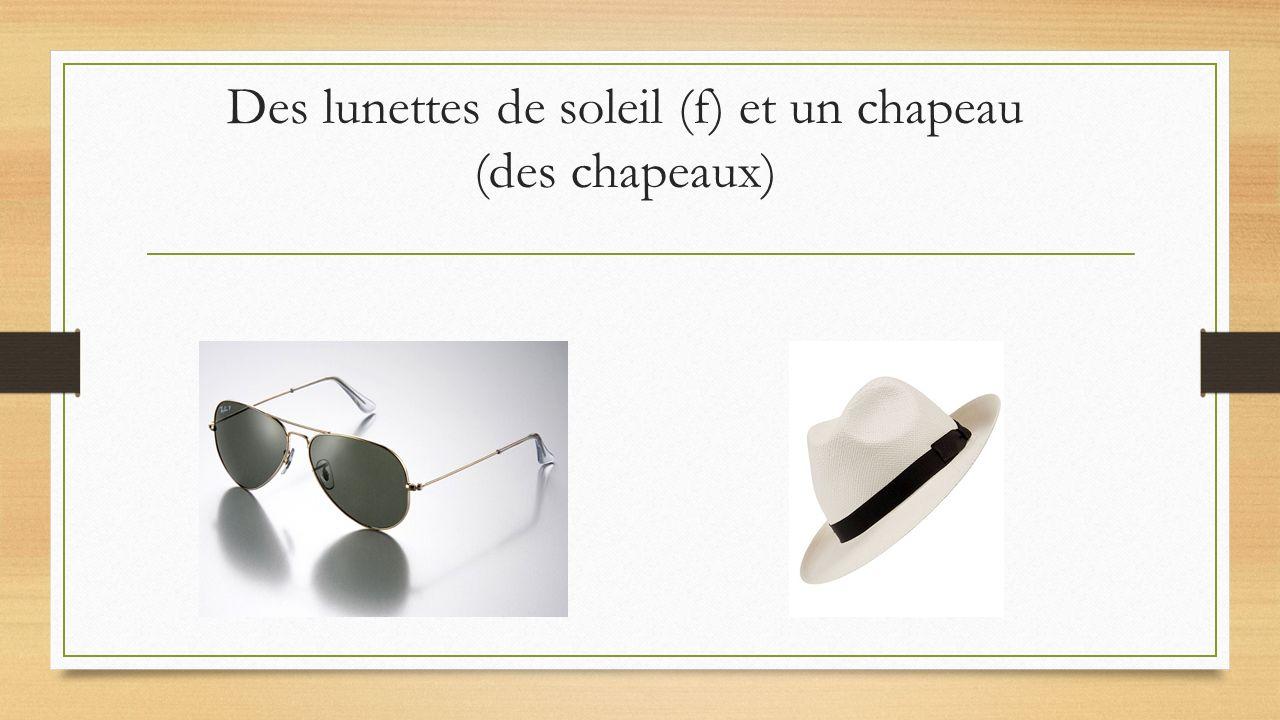 Des lunettes de soleil (f) et un chapeau (des chapeaux)