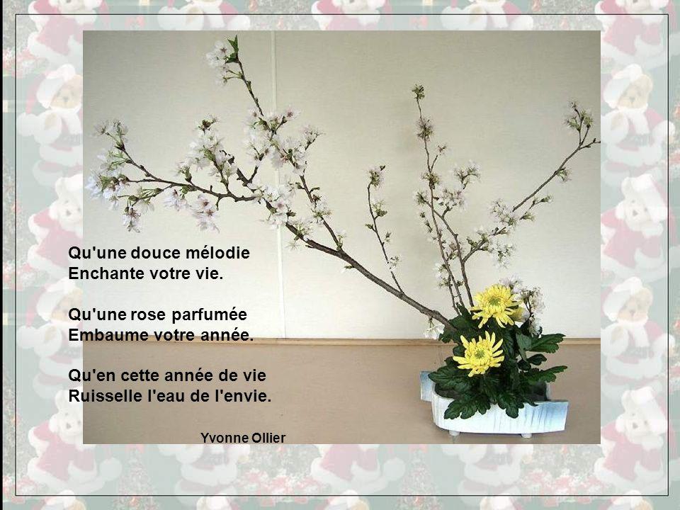 Qu une douce mélodie Enchante votre vie. Qu une rose parfumée. Embaume votre année. Qu en cette année de vie.