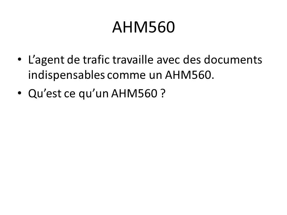AHM560 L'agent de trafic travaille avec des documents indispensables comme un AHM560.