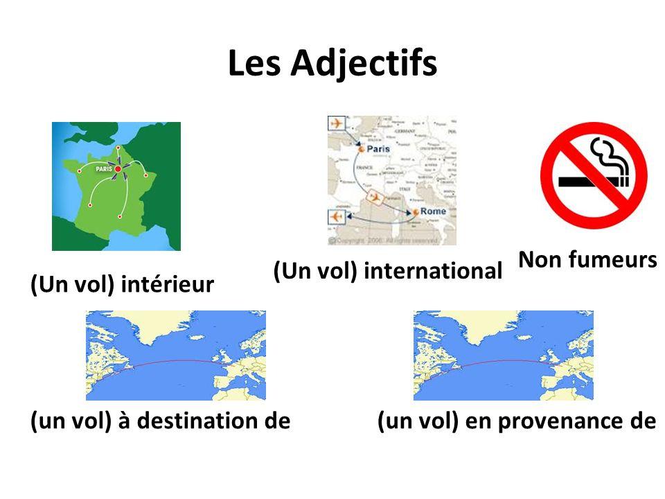 Les Adjectifs Non fumeurs (Un vol) international (Un vol) intérieur