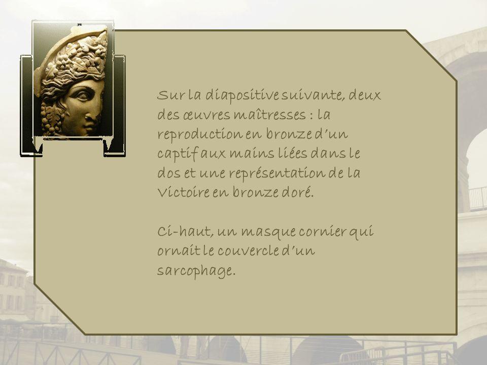 Sur la diapositive suivante, deux des œuvres maîtresses : la reproduction en bronze d'un captif aux mains liées dans le dos et une représentation de la Victoire en bronze doré.