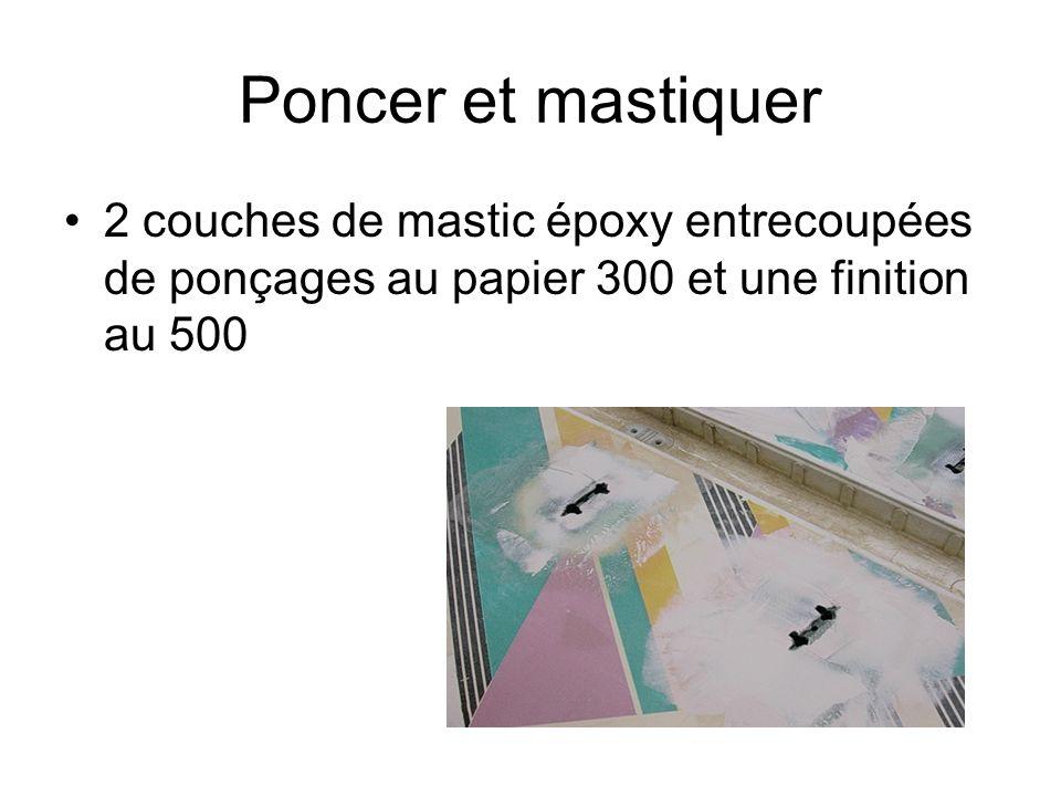 Poncer et mastiquer 2 couches de mastic époxy entrecoupées de ponçages au papier 300 et une finition au 500.