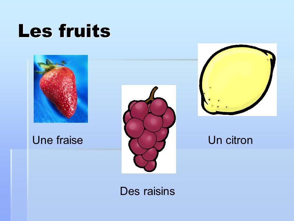Les fruits Une fraise Un citron Des raisins