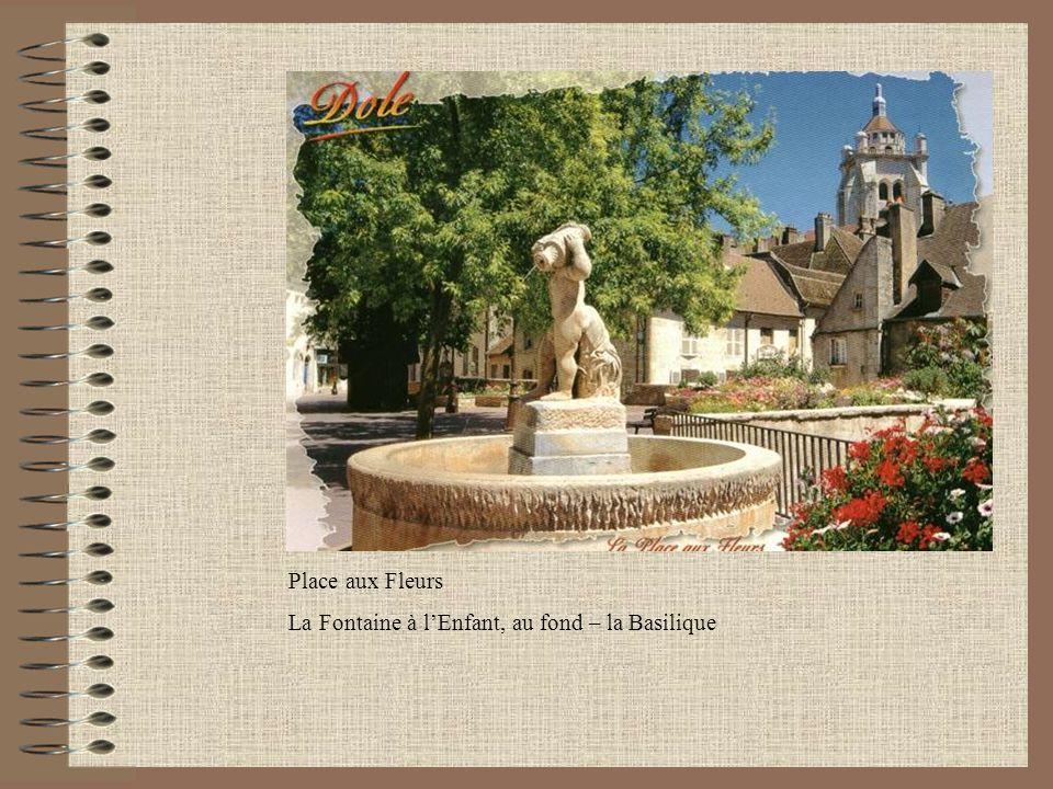 Place aux Fleurs La Fontaine à l'Enfant, au fond – la Basilique