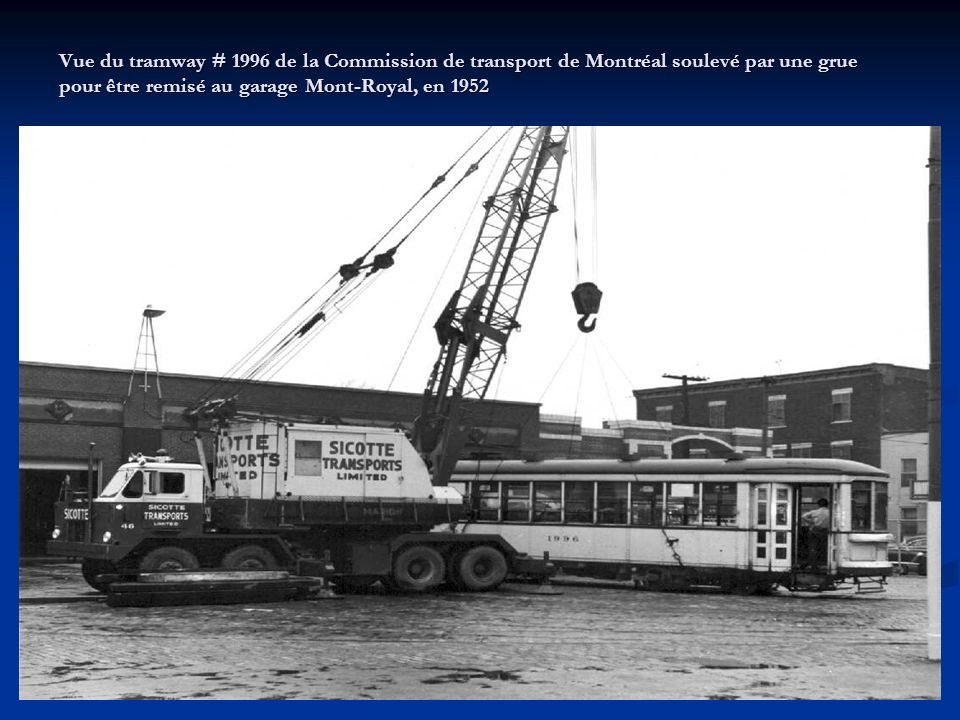Vue du tramway # 1996 de la Commission de transport de Montréal soulevé par une grue pour être remisé au garage Mont-Royal, en 1952
