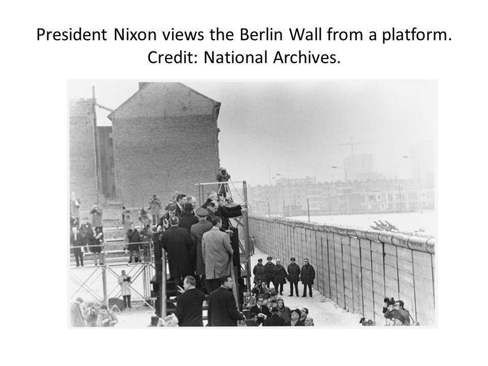 President Nixon views the Berlin Wall from a platform