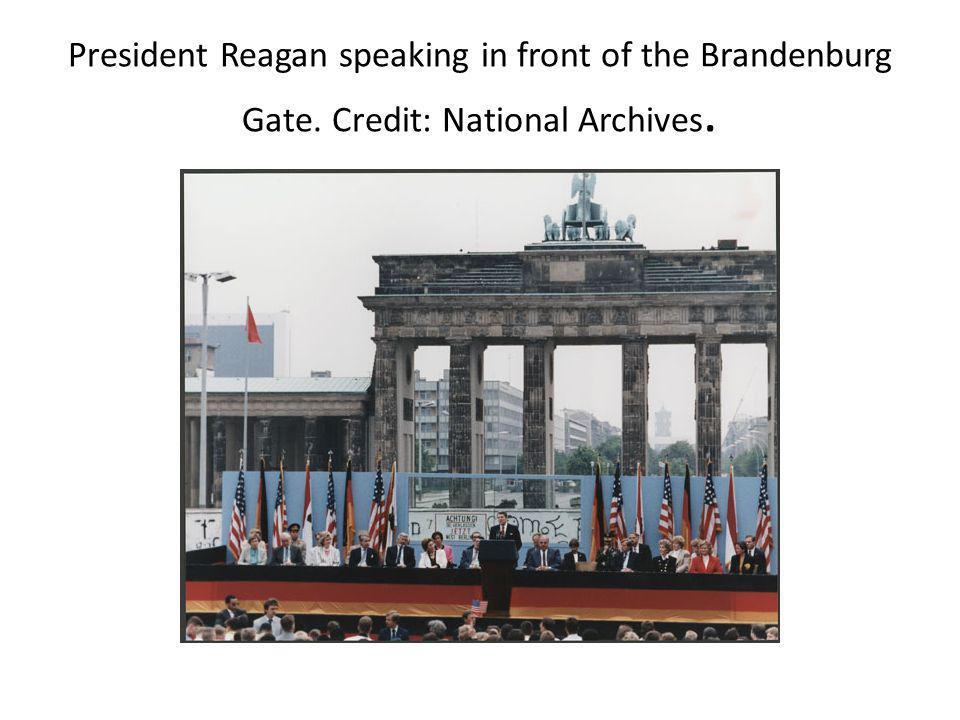 President Reagan speaking in front of the Brandenburg Gate