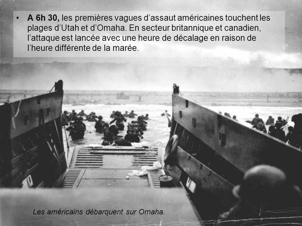 A 6h 30, les premières vagues d'assaut américaines touchent les plages d'Utah et d'Omaha. En secteur britannique et canadien, l'attaque est lancée avec une heure de décalage en raison de l'heure différente de la marée.