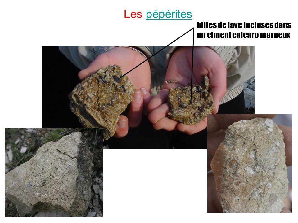 Les pépérites billes de lave incluses dans un ciment calcaro marneux