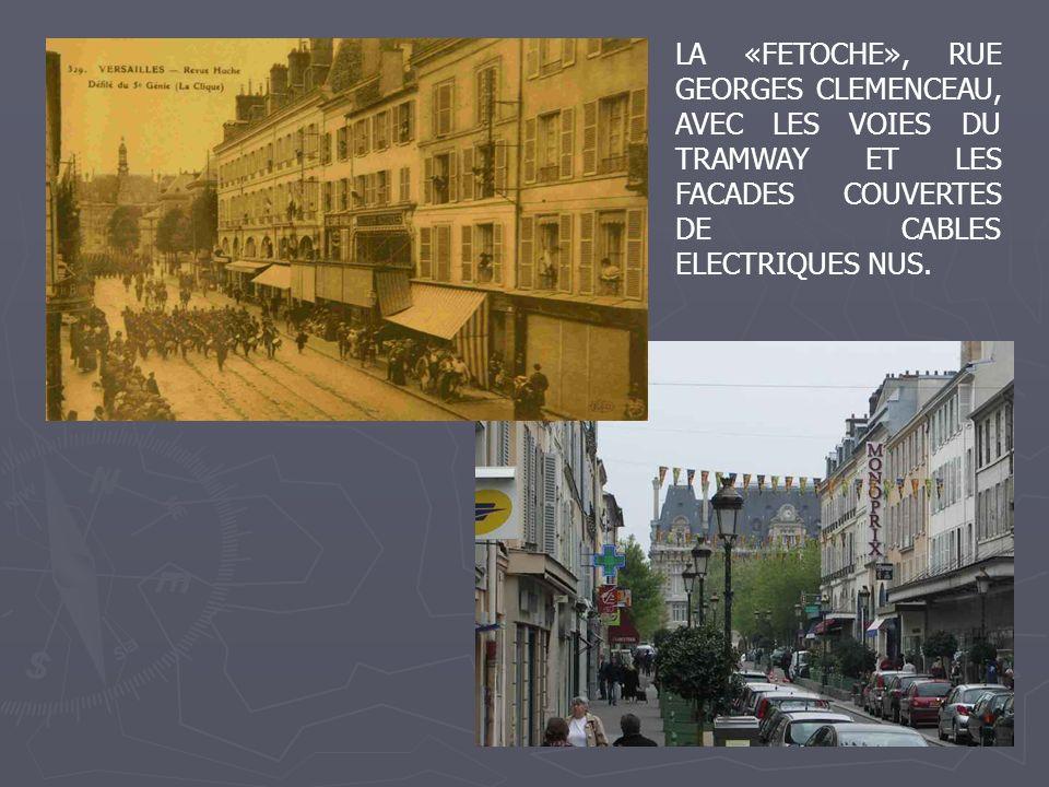 LA «FETOCHE», RUE GEORGES CLEMENCEAU, AVEC LES VOIES DU TRAMWAY ET LES FACADES COUVERTES DE CABLES ELECTRIQUES NUS.