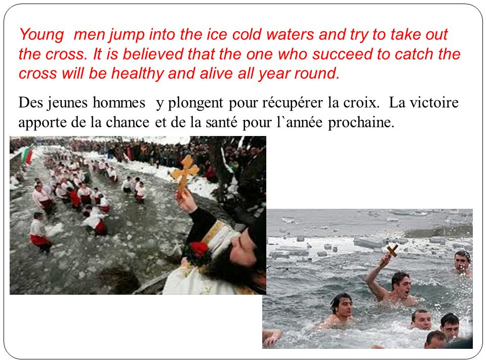 Young men jump into the ice cold waters and try to take out the cross