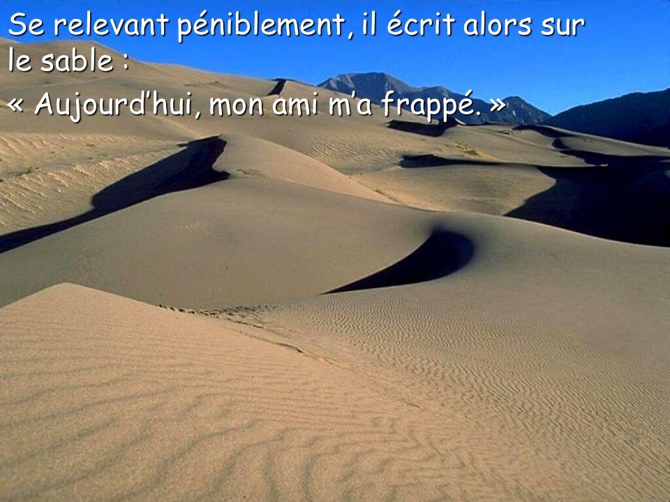 Se relevant péniblement, il écrit alors sur le sable :