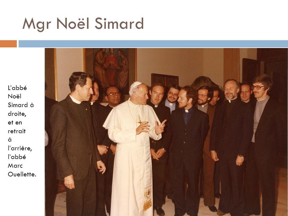 Mgr Noël Simard L'abbé Noël Simard à droite, et en retrait