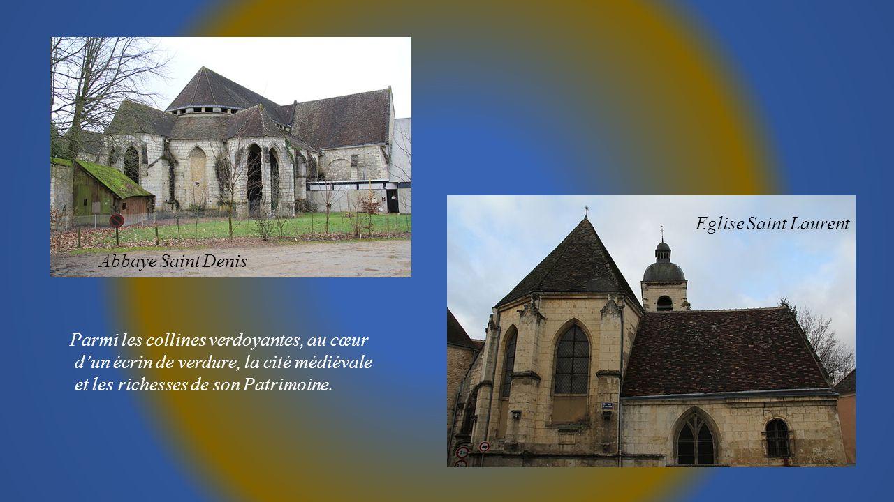 Eglise Saint Laurent Abbaye Saint Denis. Parmi les collines verdoyantes, au cœur. d'un écrin de verdure, la cité médiévale.