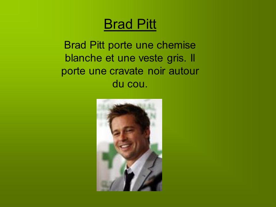 Brad Pitt Brad Pitt porte une chemise blanche et une veste gris.